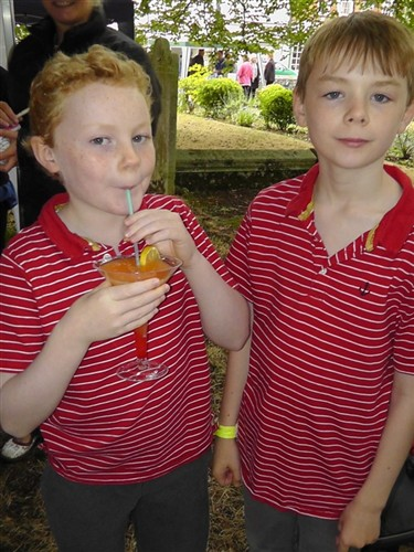 Kids drinking fruit cocktails